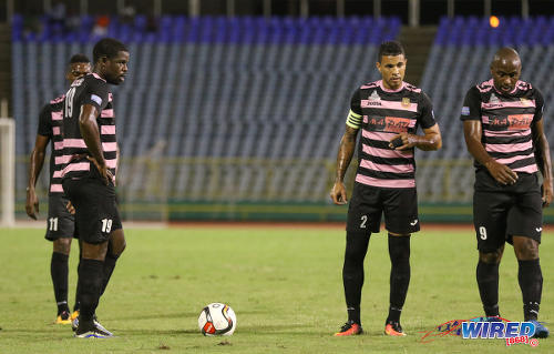 Photo: Ma Pau Stars players (from left) Glenton Wolffe, Carlos Edwards and Jason Scotland stand over a free kick during the First Citizens Bank Cup final against Defence Force at the Hasely Crawford Stadium, Port of Spain on 2 December 2016. (Courtesy Sean Morrison/Wired868)
