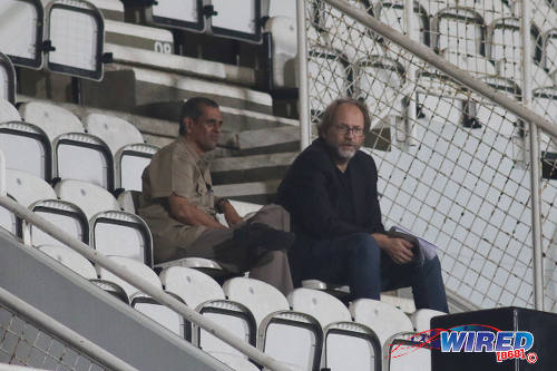 Photo: Trinidad and Tobago head coach Tom Saintfiet (right) and ex-TTFA general secretary Azaad Khan take in a Pro League contest between Central FC and W Connection at the Ato Boldon Stadium in Couva on Monday 12 December 2016. Kenwyne Jones scored a deft winner but was still excluded from the national side. (Courtesy Chevaughn Christopher/Wired868)
