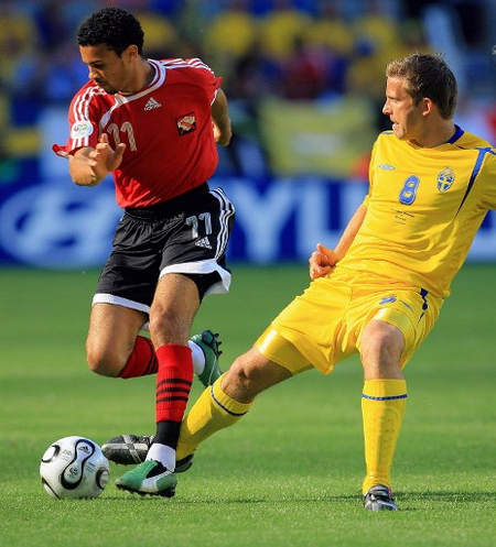 Photo: Trinidad and Tobago midfielder Carlos Edwards (left) takes on Sweden midfielder Anders Svensson during the Germany 2006 World Cup group B opener on 10 June 2006 at Dortmund stadium.  Edwards is the captain of the current Soca Warriors team. (Copyright AFP 2016/Odd Andersen)
