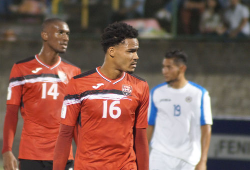 Photo: Trinidad and Tobago midfielders Alvin Jones (centre) and Hashim Arcia (left) in action against Nicaragua on 27 December 2016. (Copyright Leonel Rodriguez Ramirez/TTFA Media)