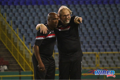 Photo: Trinidad and Tobago National Senior Team coach Tom Saintfiet (right) makes a point to paramedic Dave Isaacs during training at the Hasely Crawford Stadium in Port of Spain on 15 December 2016. (Courtesy Nicholas Williams/Wired868)