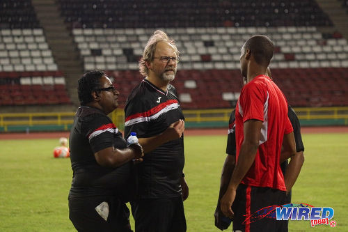 Photo: Trinidad and Tobago National Senior Team coach Tom Saintfiet (centre) and Dr Terence Babwah (left) talk to defender Carlyle Mitchell during training at the Hasely Crawford Stadium in Port of Spain on 15 December 2016. (Courtesy Nicholas Williams/Wired868)