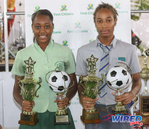"""Photo: Secondary Schools Football League (SSFL) 2016 MVPs Ke'die Johnson (left) and Tyrel """"Pappy"""" Emmanuel pose with their silverware at the National Cycling Centre in Balmain on 18 January 2017. Johnson is a St Augustine Secondary attacker while Emmanuel plays midfield for Shiva Boys Hindu College. (Courtesy Sean Morrison/Wired868)"""