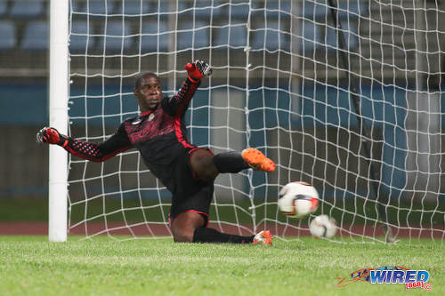 Photo: Defence Force goalkeeper Sheldon Clarke watches in despair as Central FC forward Jason Marcano's penalty flies past him during Pro League action at the Ato Boldon Stadium, Couva on 24 January 2017. (Courtesy Chevaughn Christopher/Wired868)