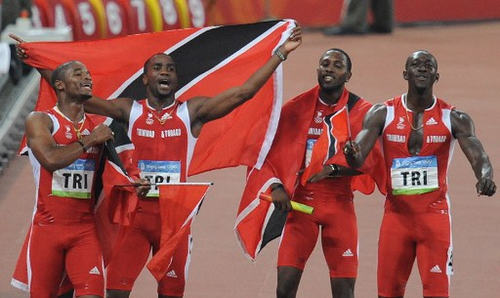 Photo: Trinidad and Tobago sprinters (from left) Keston Bledman, Emmanuel Callender, Richard Thompson and Marc Burns celebrate after winning silver in the 4x100 final during the 2008 Beijing Olympics at the Beijing National Stadium on 22 August 2008. Jamaica won the Olympic final with a new world record of 37.10 seconds. (Copyright AFP 2017/Jewel Samad)
