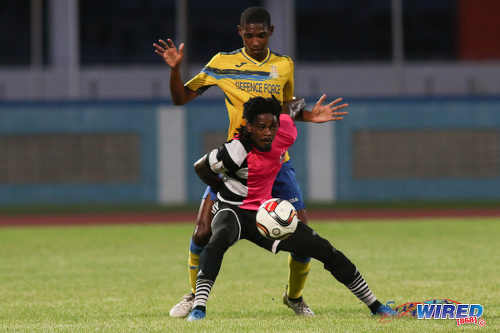 Photo: Central FC forward Jason Marcano (foreground) holds off Defence Force defender Jamali Garcia during Pro League action at the Ato Boldon Stadium, Couva on 24 January 2017. (Courtesy Chevaughn Christopher/Wired868)