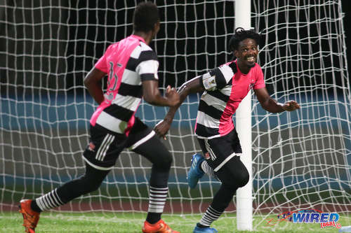 Photo: Central FC forward Jason Marcano (right) celebrates his late penalty against Defence Force during Pro League action at the Ato Boldon Stadium, Couva on 24 January 2017. Central won 2-1 to return to the top of the standings. (Courtesy Chevaughn Christopher/Wired868)