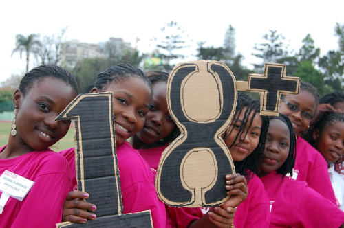 Photo: Young girls protest against child marriage in Africa. (Copyright Plan-International)