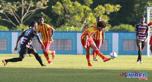 Photo: Teenaged Point Fortin Civic attacker Nion Lammy (centre) passes for a teammate during Pro League action against Ma Pau Stars at the Ato Boldon Stadium on 18 September 2016. (Courtesy Sean Morrison/Wired868)
