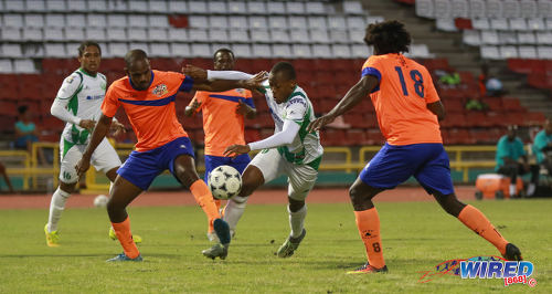 Photo: W Connection midfielder Briel Thomas (centre) and Club Sando defender Leslie Joel Russell (left) contest the ball during Pro League action on 10 January 2017 at the Hasely Crawford Stadium in Port of Spain. (Courtesy Sean Morrison/Wired868)