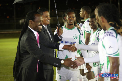 Photo: Sport Minister Darryl Smith (second from left) and Minister of Public Utilities Fitzgerald Hinds (far left) meet players from W Connection before kick off against Morvant Caledonia United at the Hasely Crawford Stadium training ground on 20 January 2017. (Courtesy Sean Morrison/Wired868)