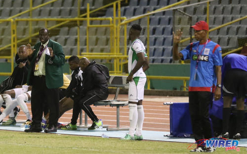 Photo: W Connection coach Stuart Charles-Fevrier (left) gives instructions to substitute Jesus Perez (centre) while St Ann's Rangers coach Anthony Streete looks on during Pro League action at the Hasely Crawford Stadium on 17 January 2017. (Courtesy Sean Morrison/Wired868)