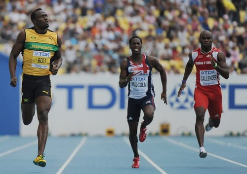 Photo: Trinidad and Tobago sprinter Emmanuel Callender (right) competes with Jamaica's Usain Bolt and Britain's Christian Malcolm in the 200 metre heats of the 2011 IAAF World Championships in Daegu on 2 September 2011. (Copyright AFP 2017/Olivier Morin)