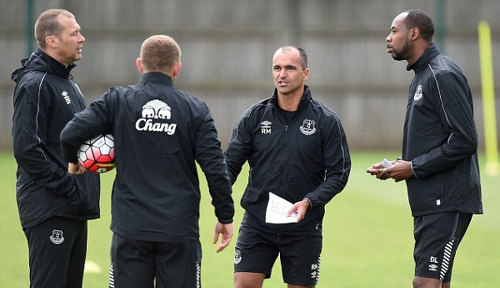 Photo: Former Everton FC manager Roberto Martinez (second from right) speaks to assistants Dennis Lawrence (far right) and Graeme Jones during a file photo.