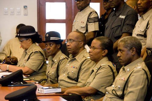 Photo: Senior members of the Trinidad and Tobago Police Service during an address by then National Security Minister John Sandy in 2010. Involved in serious discussion about protecting and serving? (Courtesy News.Gov.TT)