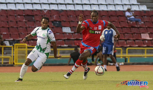 Photo: W Connection attacker Neil Benjamin Jr (left) tries to outpace St Ann's Rangers defender Samuel Delice during Pro League action at the Hasely Crawford Stadium on 17 January 2017. (Courtesy Sean Morrison/Wired868)