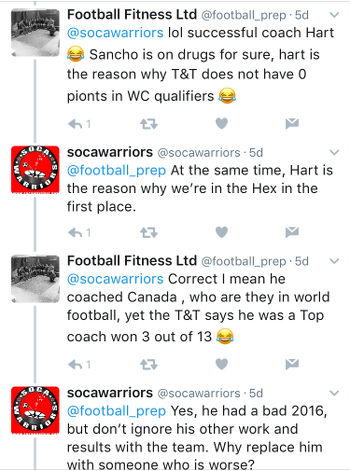 Photo: Football Fitness, presumably ex-Trinidad and Tobago football team fitness trainer Riedoh Berdien, spars with Nigel Myers from Soca Warriors on Twitter.
