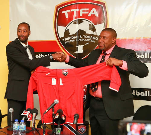 Photo: Trinidad and Tobago Football Association (TTFA) president David John-Williams (right) makes a ceremonial gesture to his new Men's National Senior Team head coach Dennis Lawrence at the TTFA headquarters on 30 January 2017. (Copyright Allan V Crane/TTFA)