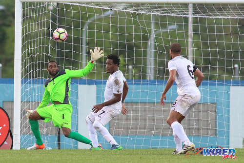 Photo: Trinidad and Tobago goalkeeper Adrian Foncette (left) reaches for the ball while defenders Maurice Ford (centre) and Radanfah Abu Bakr look on during 2017 Gold Cup playoff action against Haiti at the Ato Boldon Stadium in Couva. (Courtesy Chevaughn Christopher/Wired868)