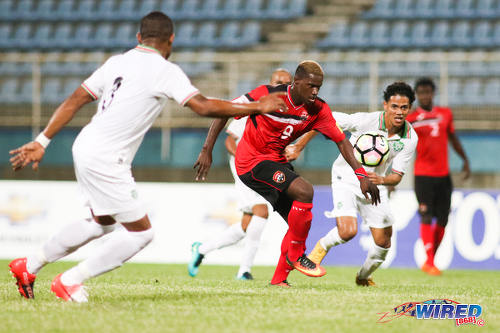Photo: Trinidad and Tobago forward Akeem Roach (centre) tries to find a route to goal during 2017 Gold Cup playoff action at the Ato Boldon Stadium, Couva on 4 January 2017. (Courtesy Chevaughn Christopher/Wired868)