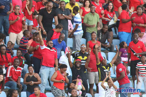 Photo: Soca Warriors supporters cheer on their team during 2017 Gold Cup playoff action against Haiti at the Ato Boldon Stadium in Couva. (Courtesy Chevaughn Christopher/Wired868)