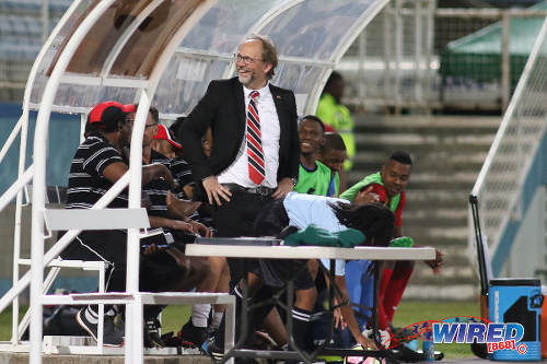 Photo: Trinidad and Tobago National Senior Team coach Tom Saintfiet shares a light moment with a member of the crowd during 2017 Gold Cup playoff action against Suriname at the Ato Boldon Stadium, Couva on 4 January 2017. (Courtesy Chevaughn Christopher/Wired868)
