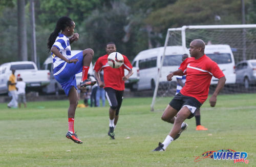 Photo: Wired868 and Trinidad and Tobago Women's National Senior Team winger Ahkeela Mollon (left) passes the ball away from opposing defender Raefer Ross at the Wired868 Football Festival V at UWI admin ground on 7 January 2017. (Courtesy Sean Morrison/Wired868)
