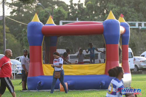 Photo: Right... My time now! Cortlyn Smith (centre) leaves her daughter to have fun in the bouncy castle and heads to take in the fun at the Wired868 Football Festival V at UWI admin ground on 7 January 2017. (Courtesy Sean Morrison/Wired868)