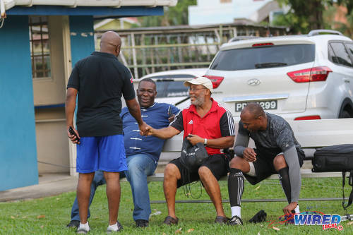 Photo: Catching up. Former Trinidad and Tobago international footballer and legendary SSFL coach Michael Grayson (centre) greets Wired868 managing director Lasana Liburd while former national youth team goalkeeper and Presentation College (San Fernando) goalkeeper coach Jefferson George (right) and ex-Soca Warriors team manager William Wallace look on at the Wired868 Football Festival V at UWI admin ground on 7 January 2017. (Courtesy Sean Morrison/Wired868)