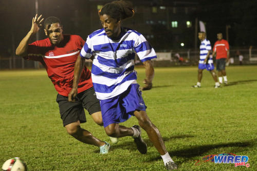 Photo: Former Trinidad and Tobago national youth team star Marvin Oliver (right) tries to shake off Football Factory coach Kevin Eiffel at the Wired868 Football Festival V at UWI admin ground on 7 January 2017. (Courtesy Sean Morrison/Wired868)