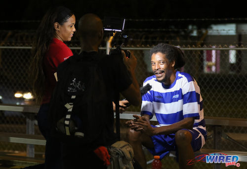 Photo: Tell us how you did it... Wired868 operations manager Lou-Ann Sankar (left) and Expressions MH videographer Dannel Flaveny interview MVP Marvin Oliver at the Wired868 Football Festival V at UWI admin ground on 7 January 2017. (Courtesy Sean Morrison/Wired868)