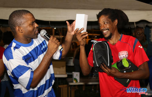 Photo: Wired868 Football Festival V MVP Marvin Oliver (right) shows off his new Bmobile Samsung Galaxy phone to host Tyrone Marcus from the Wired868 Football Festival V at UWI admin ground on 7 January 2017. Bmobile sponsored the MVP prize. (Courtesy Sean Morrison/Wired868)