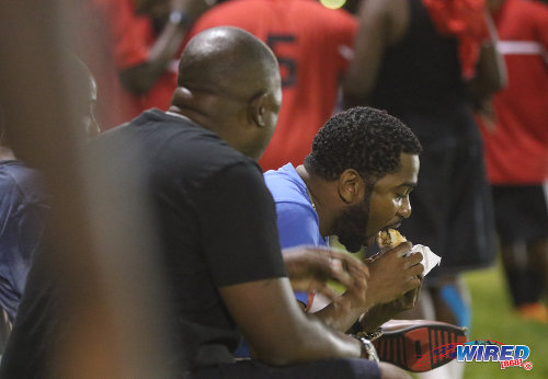 Photo: The eats were great too... Longtime Wired868 supporter and former St Augustine Secondary football Rodney Alexander (right) enjoys a Matchstix burger at the Wired868 Football Festival V at UWI admin ground on 7 January 2017. (Courtesy Sean Morrison/Wired868)