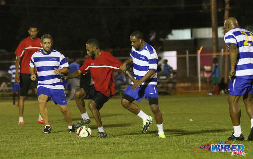 "Photo: Invitational XI attacker Gary Glasgow (centre) tries to keep the ball from Ronald ""Bor Bor"" Boyce (second from right) and Kevin Moze (second from left) while Anthony Rougier (far right) and Fuad Abu Bakr (far left) look on in the Wired868 Football Festival V at UWI admin ground on 7 January 2017. (Courtesy Sean Morrison/Wired868)"