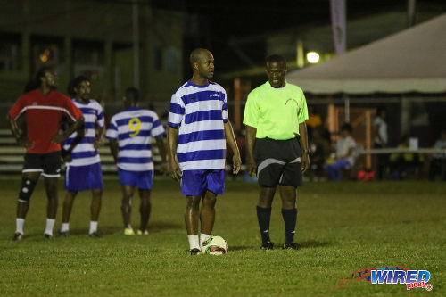 "Photo: Former Guaya United and Caledonia AIA standout Ryan ""Fry"" Stewart (centre) prepares to take a penalty while referee Bevon Spencer (right) looks on in the Wired868 Football Festival V at UWI admin ground on 7 January 2017. (Courtesy Sean Morrison/Wired868)"