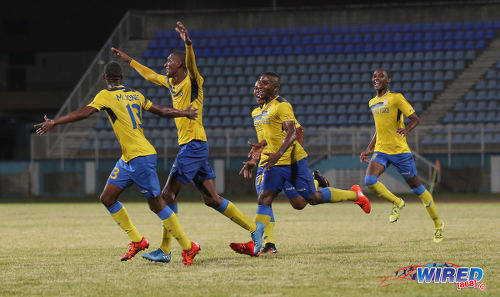 Photo: Defence Force goal scorer Hashim Arcia (second from left) celebrates with his teammates during their Pro Bowl semifinal win over Police FC at the Ato Boldon Stadium on 12 February 2017. Defence Force won 4-0. (Courtesy Sean Morrison/Wired868)