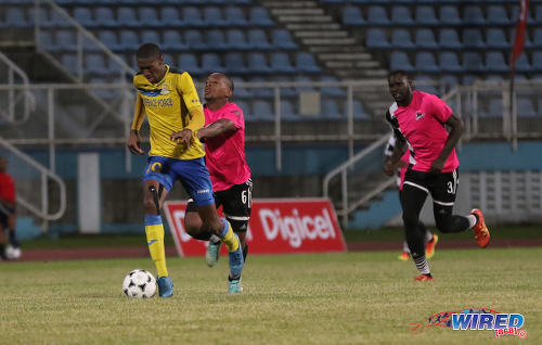Photo: Defence Force attacker Hashim Arcia (left) heads to goal while Central FC midfielder Leston Paul (centre) tries to hang on and defender Keion Goodridge looks on in the Pro Bowl final on 19 February 2017 at the Ato Boldon Stadium. Defence Force won 5-3 on kicks from the penalty mark after a 2-2 draw. (Courtesy Sean Morrison/Wired868)