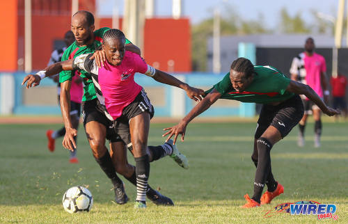 Photo: Central FC captain Darren Mitchell (centre) tussles with San Juan Jabloteh players Nathan Lewis (right) and Akeem Benjamin during Pro League action at the Ato Boldon Stadium in Couva on 5 February 2017. (Courtesy Sean Morrison/Wired868)