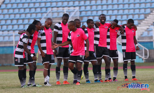 Photo: Centrala FC midfielder Leston Paul (centre) is congratulated by teammates after his successful penalty against Club Sando during the Pro Bowl semifinals at the Ato Boldon Stadium on 12 February 2017. Central won 5-4 via kicks from the penalty mark. (Courtesy Sean Morrison/Wired868)