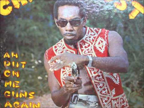 "Photo: Hollis ""Chalkdust"" Liverpool poses in 1976 when he won his first Calypso Monarch crown with ""No Smut For Me"" and ""Ah Put On Meh Guns Again""."