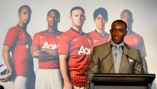 Photo: Former Trinidad and Tobago and Manchester United footballer Dwight Yorke speaks at a press conference in Sydney on 10 December 2012, at the announcement of an exhibition match between English Premier League team Manchester United and an Australian A-League All Stars team in a one-off game in 2013. (Copyright AFP 2017/William West)