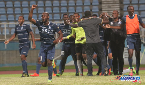 Photo: Police FC defender Dexter Alleyne (second from left) punches the air while his teammates congratulate goalkeeper Adrian Foncette (centre) after their penalty shootout win over W Connection in Digicel Pro Bowl quarterfinal action at the Ato Boldon Stadium in Couva on 8 February 2017. (Courtesy Sean Morrison/Wired868)