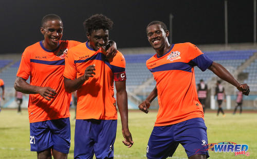 Photo: Club Sando players (from left) Jayson Joseph, Akeem Humphrey and Akeem Roach celebrate during their 2-0 Digicel Pro Bowl quarterfinal win over Ma Pau Stars at the Ato Boldon Stadium in Couva on 9 February 2017. (Courtesy Sean Morrison/Wired868)