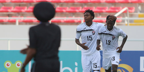 Photo: Trinidad and Tobago National Under-20 Team winger Kathon St Hillaire (centre) celebrates with teammate Micah Lansiquot during 2017 World Cup qualifying action against El Salvador at the Estadio Nacional on 22 February 2017. Hillaire scored the winner, off a Lansiquot pass, as T&T won 2-1. (Copyright Straffon Images)
