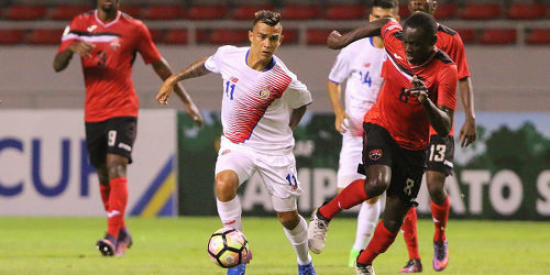Photo: Trinidad and Tobago National Under-20 Team midfielder Kierron Mason (right) challenges Costa Rica midfielder Randall Leal (centre) during 2017 World Cup qualifying action against Costa Rica at the Estadio Nacional on 22 February 2017. Costa Rica won 1-0. (Copyright Straffon Images)