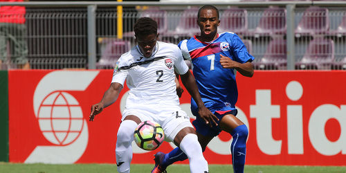 Photo: Trinidad and Tobago National Under-20 Team right back Isaiah Garcia (left) tries to keep the ball away from Bermuda National Under-20 striker Oneko Lowe during 2017 World Cup qualifying action at the Estadio Ricardo Saprissa on 19 February 2017. (Copyright Victor Straffon/Straffon Images)