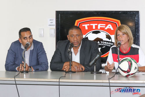 Photo: Trinidad and Tobago Football Association (TTFA) president David John-Williams (centre) is flanked by Women's National Senior Team coach Carolina Morace (right) and press officer Shaun Fuentes at a press conference in the Ato Boldon Stadium, Couva on 1 February 2017. (Courtesy Sean Morrison/Wired868)