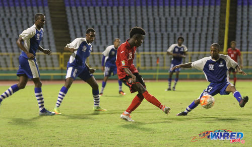 Photo: Trinidad and Tobago Under-20 Team midfielder and captain Jabari Mitchell (centre) passes the ball during a practice game against St Ann's Rangers at the Hasely Crawford Stadium in Port of Spain. (Courtesy Sean Morrison/Wired868)