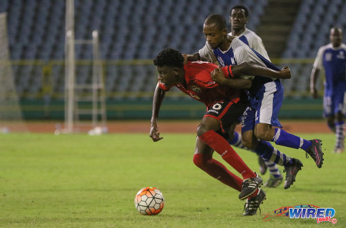 Photo: Trinidad and Tobago National Under-20 Team midfielder Joshua Sitney (left) tries to shrug off the attentions of a St Ann's Rangers player during a practice game at the Hasely Crawford Stadium in Port of Spain. (Courtesy Sean Morrison/Wired868)