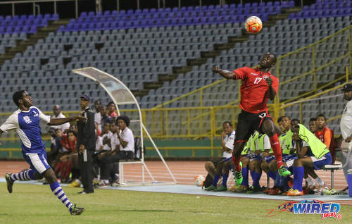 Photo: Trinidad and Tobago National Under-20 Team defender Kierron Mason (right) keeps his eye on the ball during a practice game with St Ann's Rangers at the Hasely Crawford Stadium in Port of Spain. (Courtesy Sean Morrison/Wired868)